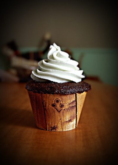 Chocolate cupcake with vanilla buttercream. I made the liner myself. Gotta love wood paneling.%0ASubmitted by NellieCakes